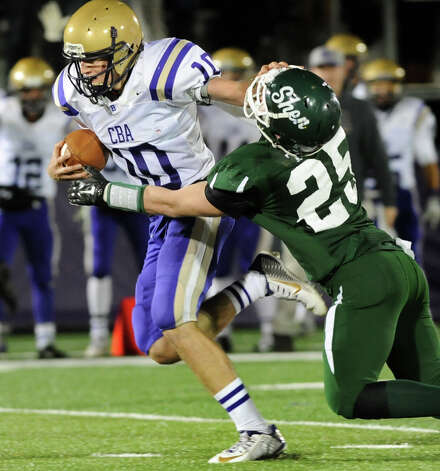 CBA's Donald Vivian, left, stiff arms Shen's Matt Taft during their Class AA Super Bowl on Friday, Nov. 7, 2014, at Bob Ford Field in Albany, N.Y. (Cindy Schultz / Times Union) Photo: Cindy Schultz / 00029384A