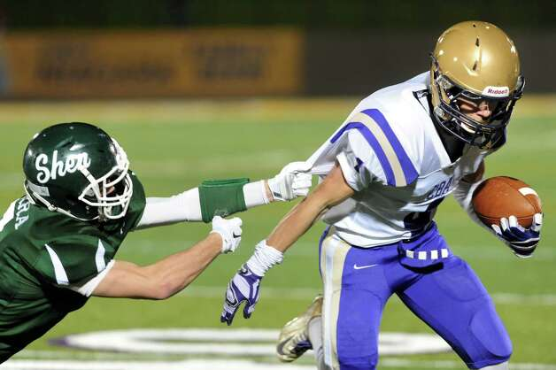 CBA's Ben Anthony, right, gains yards as Shen's Brendan Marra defends during their Class AA Super Bowl on Friday, Nov. 7, 2014, at Bob Ford Field in Albany, N.Y. (Cindy Schultz / Times Union) Photo: Cindy Schultz / 00029384A