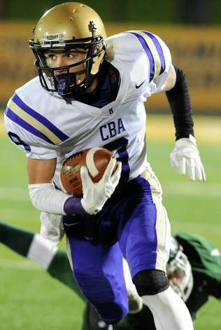 CBA's Austin Ellis carries the ball during their Class AA Super Bowl against Shen on Friday, Nov. 7, 2014, at Bob Ford Field in Albany, N.Y. (Cindy Schultz / Times Union) Photo: Cindy Schultz / 00029384A