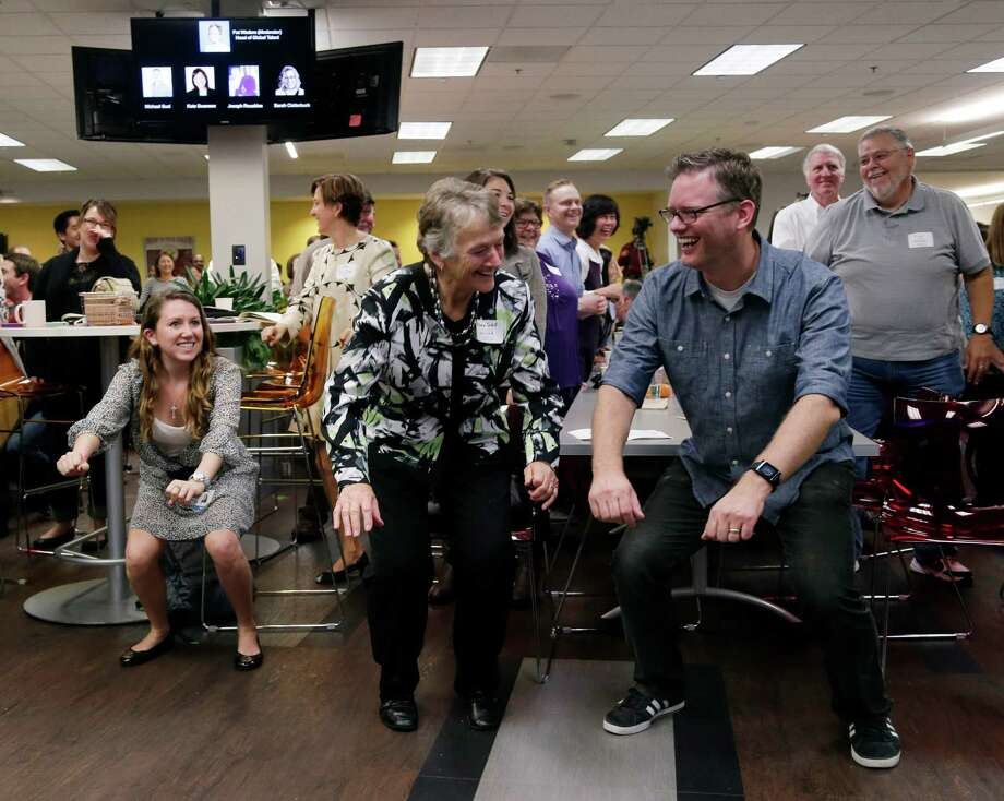 "LinkedIn employee Rob Schill, right, does stretches with his mom, Barbara, during the company's ""Bring In Your Parents Day"" last week in Mountain View, Calif. Children get to showcase cultural and technological changes in business. Photo: Marcio Jose Sanchez, STF / AP"