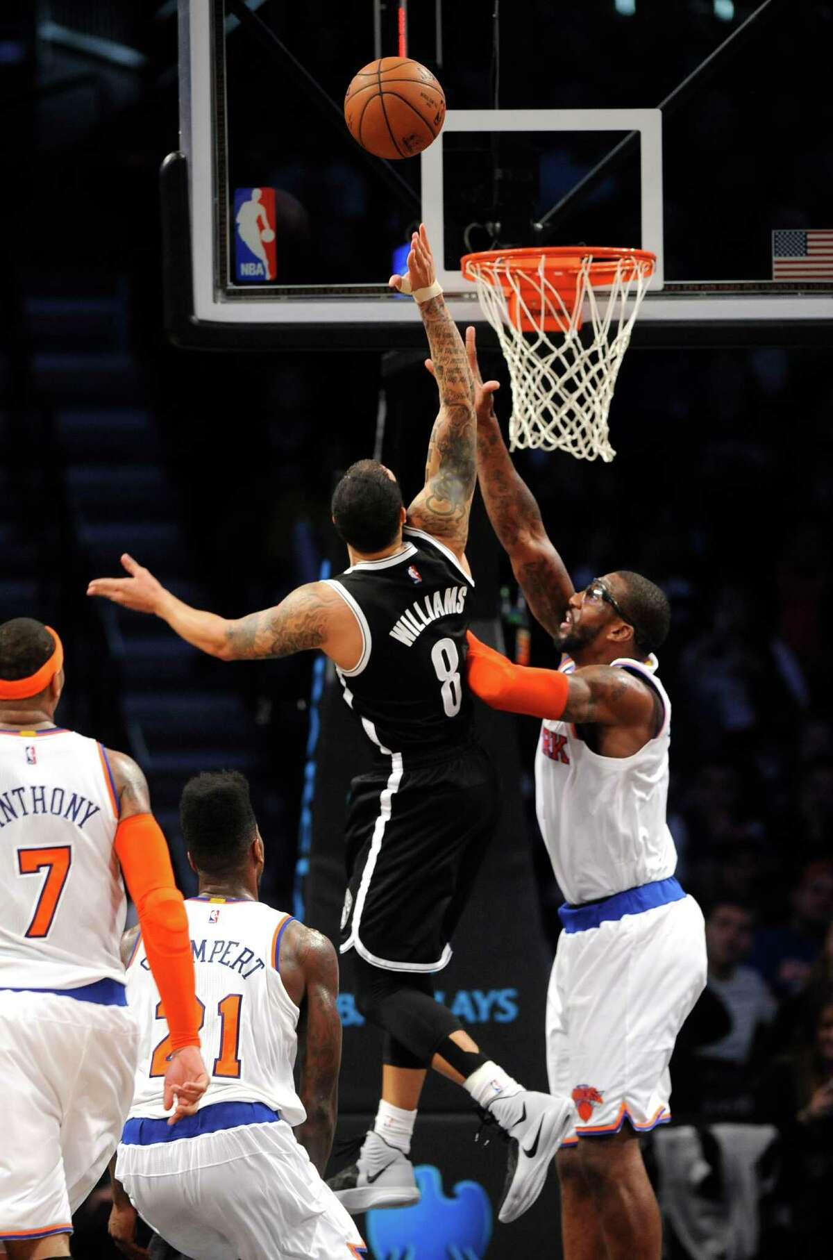 Brooklyn Nets guard Deron Williams (8) shoots a basket over New York Knicks forward Amare Stoudemire (1) during the second half of an NBA basketball game on Friday, Nov. 7, 2014, at Barclays Center in New York. The Nets won 110-99. (AP Photo/Kathy Kmonicek) ORG XMIT: NYKK109