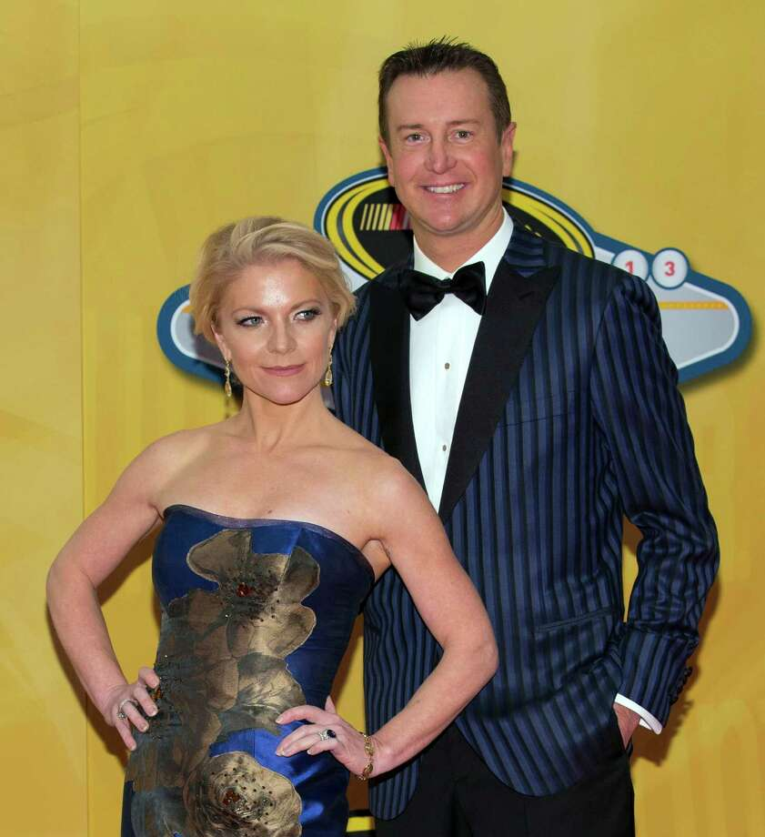 FILE - In this Dec. 6, 2013, file photo, Kurt Busch and Patricia Driscoll arrive at the NASCAR Sprint Cup Series auto racing awards ceremony at The Wynn Resort & Casino in Las Vegas. Police in Delaware say they are investigating a domestic assault allegation made against NASCAR driver Kurt Busch. The Dover Police Department said in a statement Friday, Nov. 7, 2014,  that the allegations were brought to the department on Wednesday. His ex-girlfriend, Patricia Driscoll, said the allegations involved an incident inside his motorhome at a race. (AP Photo/Eric Jamison, File) Photo: Eric Jamison, FRE / FR156391 AP