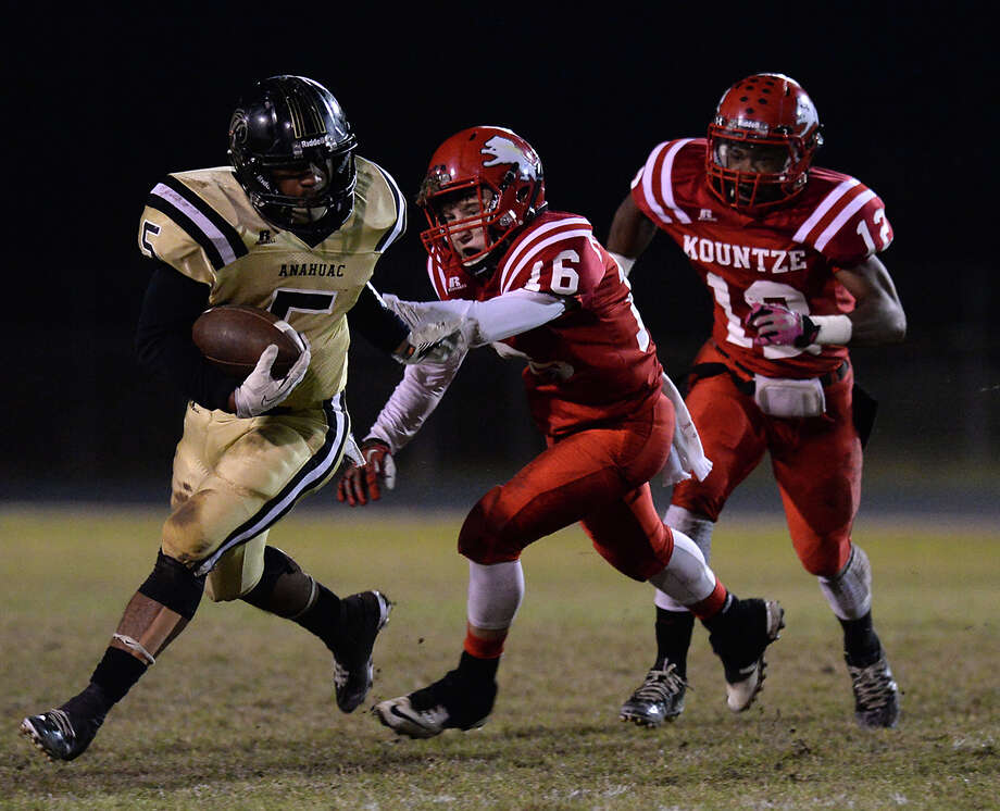 Kountze's Caden Coplen chases down the Anahuac runner during Friday's game at Kountze High School.  Photo taken Friday, November 7, 2014  Kim Brent/@kimbpix Photo: KIM BRENT / Beaumont Enterprise