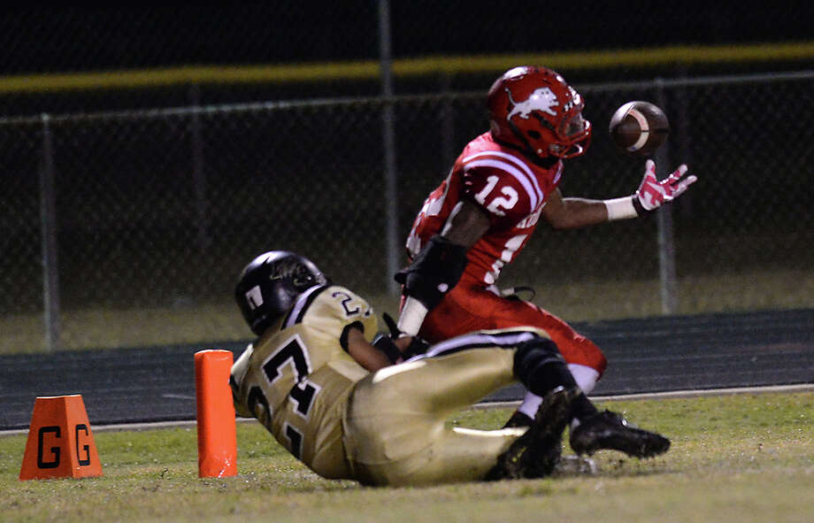 Kountze's Justin Harper tries to keep hold of the ball in the enzone as Anahuac applies the pressure during Friday's game at Kountze High School. Photo taken Friday, November 7, 2014 Kim Brent/@kimbpix Photo: KIM BRENT / Beaumont Enterprise