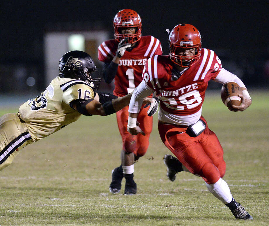 Kountze's Jace Warren outruns Anahuac's defense as he heads toward the enzone during Friday's game at Kountze High School. Photo taken Friday, November 7, 2014 Kim Brent/@kimbpix Photo: KIM BRENT / Beaumont Enterprise