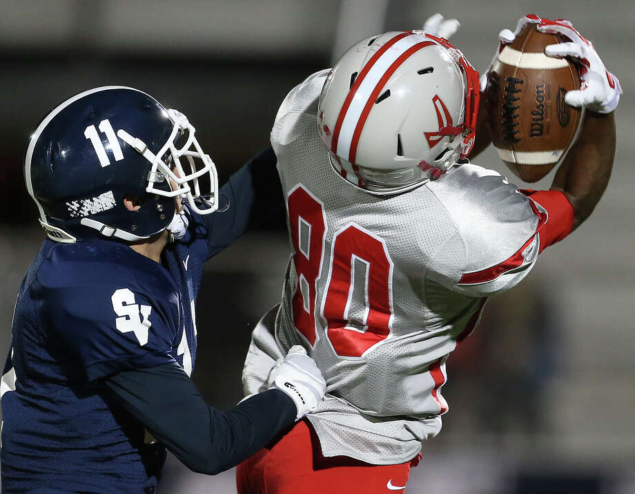 Rocket receiver Michael Akai pulls in a long pass behind Randy Rios as Judson hosts Smithson Valley at Rutledge Stadium  on November 7, 2014. Photo: TOM REEL