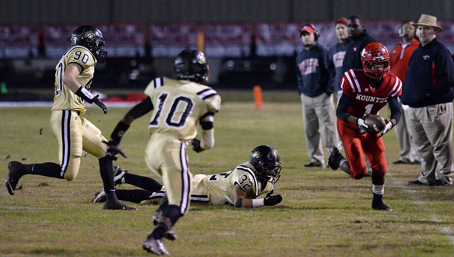 Kountze's Grayland Arnold hustles down the line as he looks to evade Anahuac's defense during Friday's game at Kountze High School. Photo taken Friday, November 7, 2014 Kim Brent/@kimbpix Photo: KIM BRENT / Beaumont Enterprise
