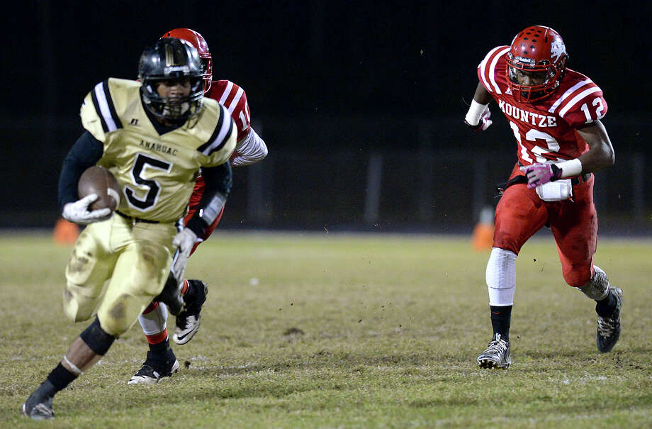 Kountze's Justin Harper chases down the Anahuac ball carrier during Friday's game at Kountze High School. Photo taken Friday, November 7, 2014 Kim Brent/@kimbpix Photo: KIM BRENT / Beaumont Enterprise