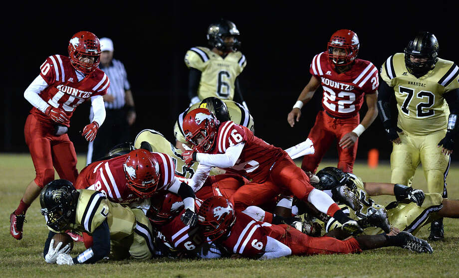 Kountze's defense, including Caden Coplen (#16) pile atop the Anahuac ball carrier during Friday's game at Kountze High School. Photo taken Friday, November 7, 2014 Kim Brent/@kimbpix Photo: KIM BRENT / Beaumont Enterprise
