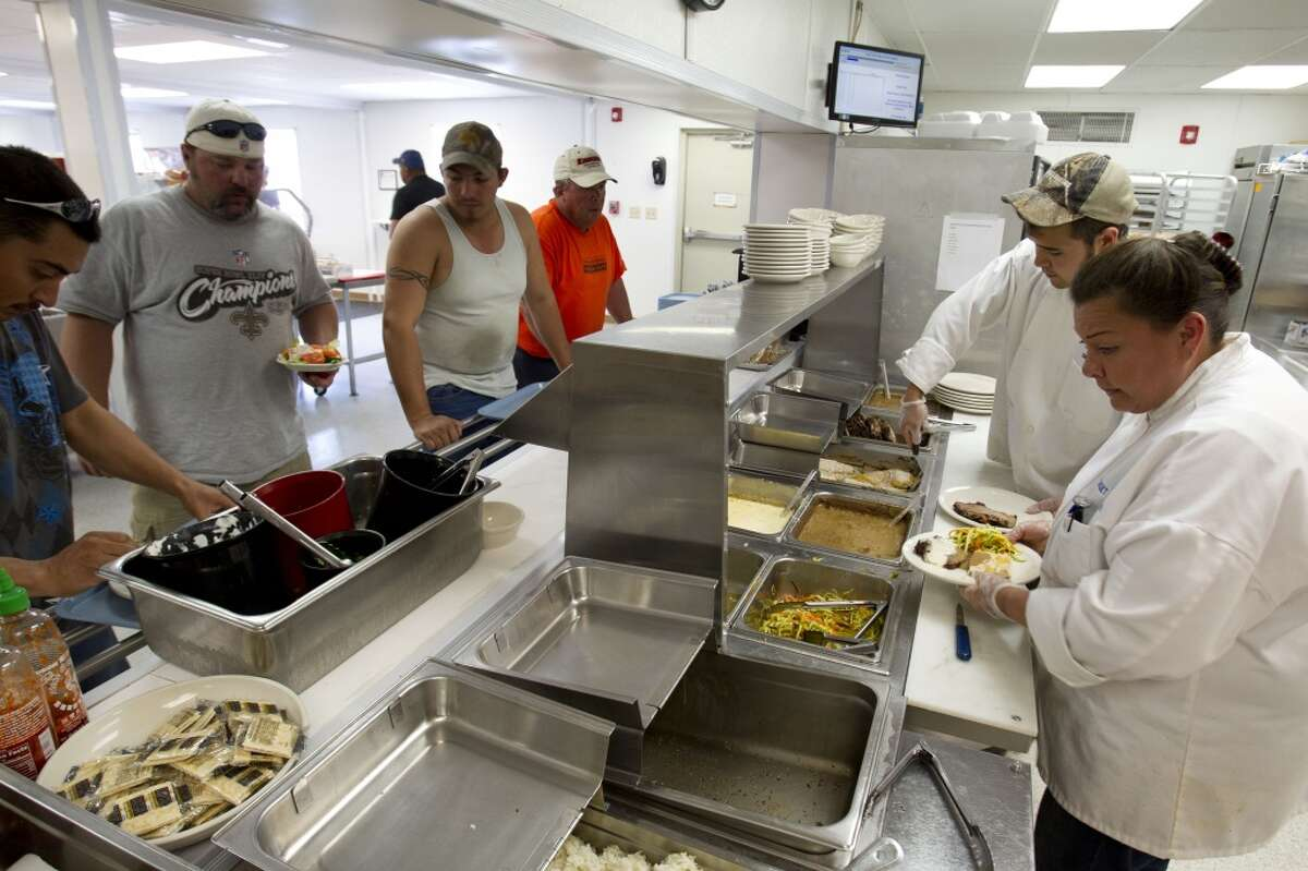 Workers line up for dinner at a temporary housing unit outside of Willisburg, N.D. With what many are calling the largest oil boom in recent North American history, temporary housing for the huge influx of workers, known as