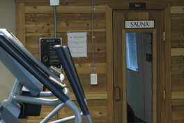"A sauna in a gym at Target Logistics' Bear Paw Lodge near Williston, N.D., is seen in this Oct. 1, 2014 photo. The 496-bed man camp features a 24-hour dining hall, a gym equipped with a sauna and a convenience store. While the words ""man camp"" might imply a certain roughness of life, the top-end man camps today look like luxury overseas military bases and function almost like hotels. Man camps are a common form of accommodation for workers in North Dakota's oil patch. (AP Photo/Josh Wood)"