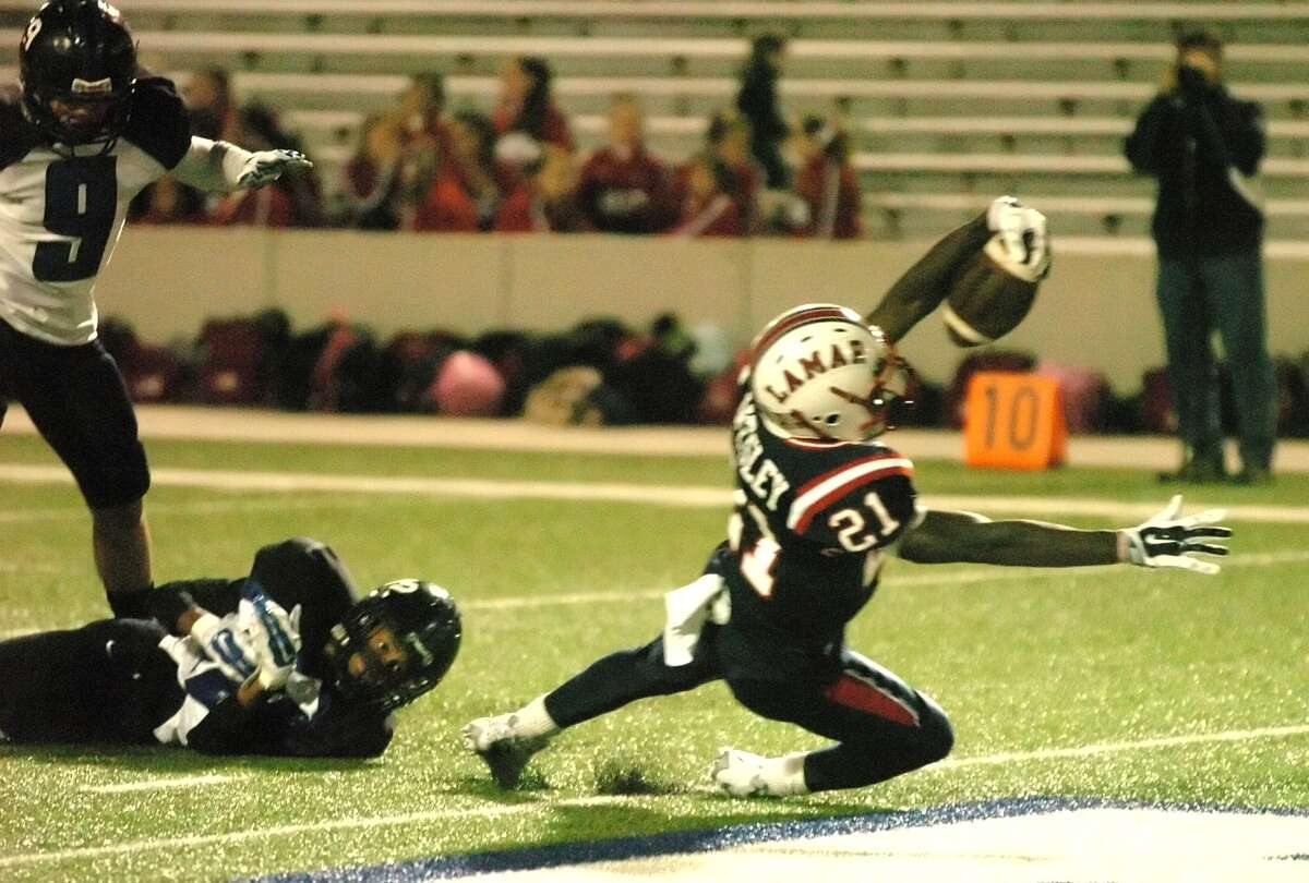 Lamar running back, Ronnie Wesley, (21) , crosses the goal line for his second touchdown of the first quarter during Lamar's win over Westside Nov. 7 at Delmar Stadium.