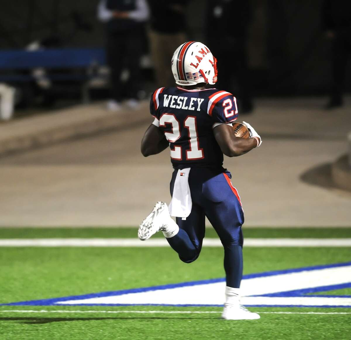 Lamar running back Ronnie Wesley (21) broke away for a 60 yard touchdown run on the teams first offensive play of the game during Lamar's win over Westside Nov. 7 at Delmar Stadium.