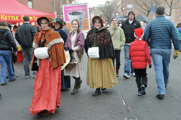 People walk the street dress in victorian costumes during the 30th annual Victorian Stroll Sunday Dec. 2, 2012 in Troy, N.Y. (Lori Van Buren / Times Union) Photo: Lori Van Buren / 00020288A