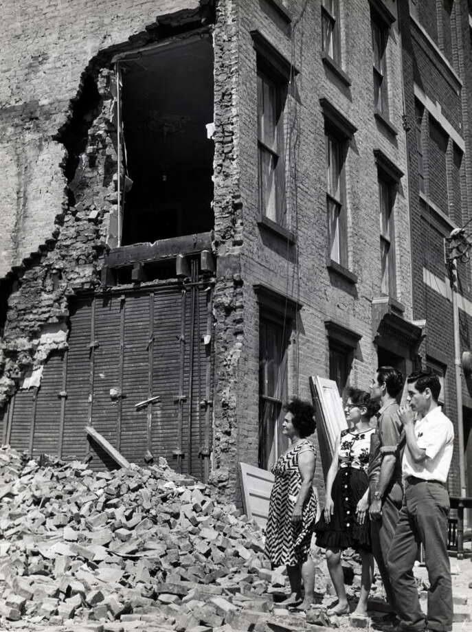 Demolished homes on the South Mall site are inspected by curious passers by July 19, 1962, on an unknown street in Albany, N.Y. (Times Union archive)