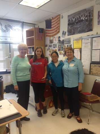 Judy Benner, left, and Jan Precopia, far right, from North Albany American Legion Auxiliary presented certificates and awards to Aurora Trainor and Michelle Yu, students at Guilderland High School for winning the National American Legion Auxiliary Americanism Essay Contest (Eastern Division) in each of their grade levels.  They each received a monetary award as well as a donation in their name to the National President's Scholarship for children of military currently deployed in the Middle East.