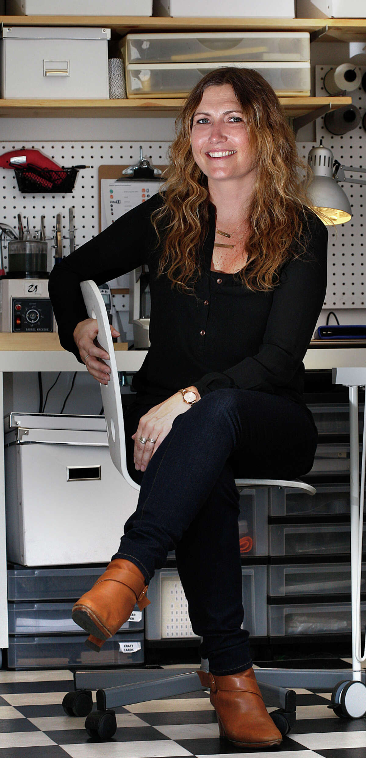 Jewelry maker Molly Cruit of the Urban Smith in her Mission District studio.