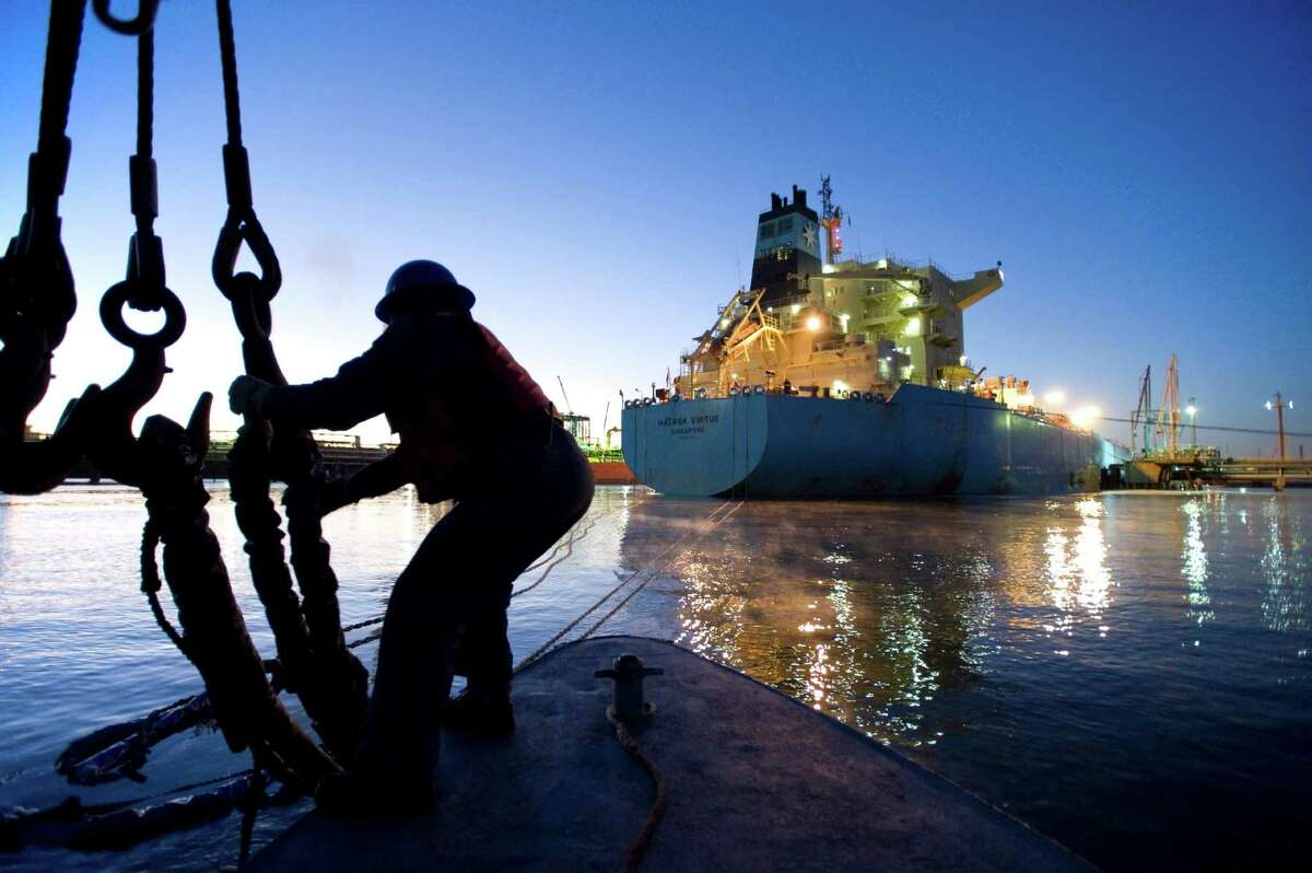 A lineman lets go of the mooring lines of a ship early in the morning. The Port of Houston is the top-ranked U.S. port in foreign tonnage.