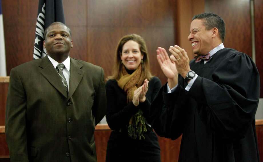 Marvin Ben, left, a Gulf War veteran, with attorney Staci Biggar, center, and Judge Marc Carter during Ben's graduation from Harris County Veterans' Court. Photo: Melissa Phillip, Staff / Houston Chronicle