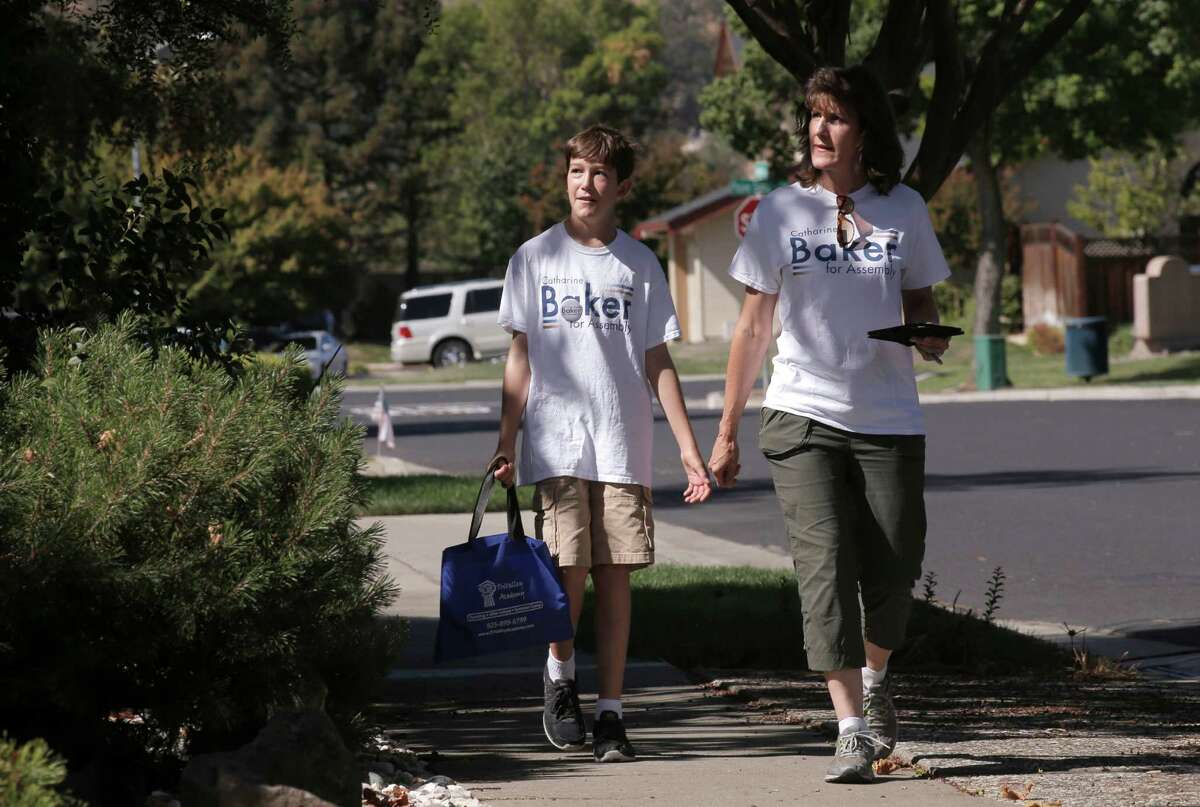 Assemblywoman-elect Catharine Baker campaigns in a Pleasanton neighborhood with her son Alex in September.