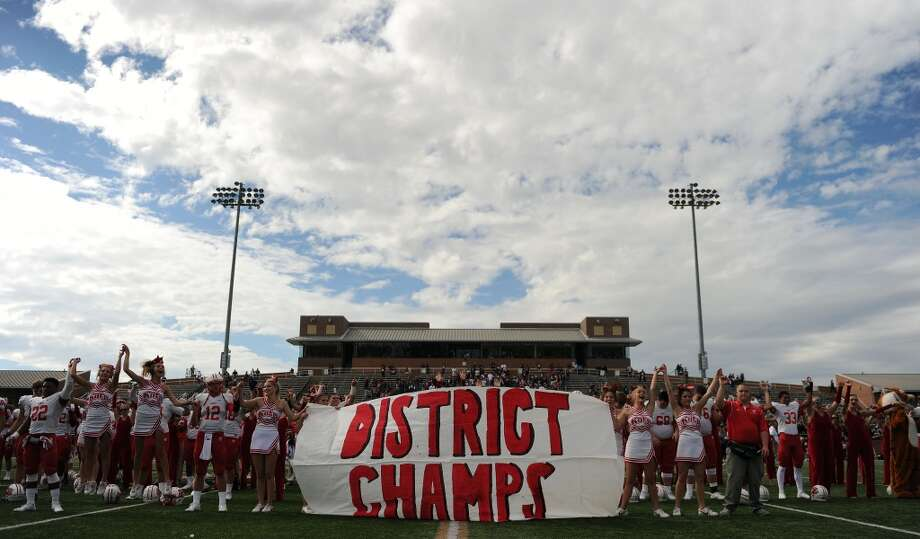 Katy players and cheerleaders celebrate the Katy Tigers' district championship after a high school football game against Cinco Ranch, Saturday, November 8, 2014, at Rhodes Stadium in Katy. (Photo: Eric Christian Smith/For the Chronicle) Photo: Eric Christian Smith, For The Chronicle