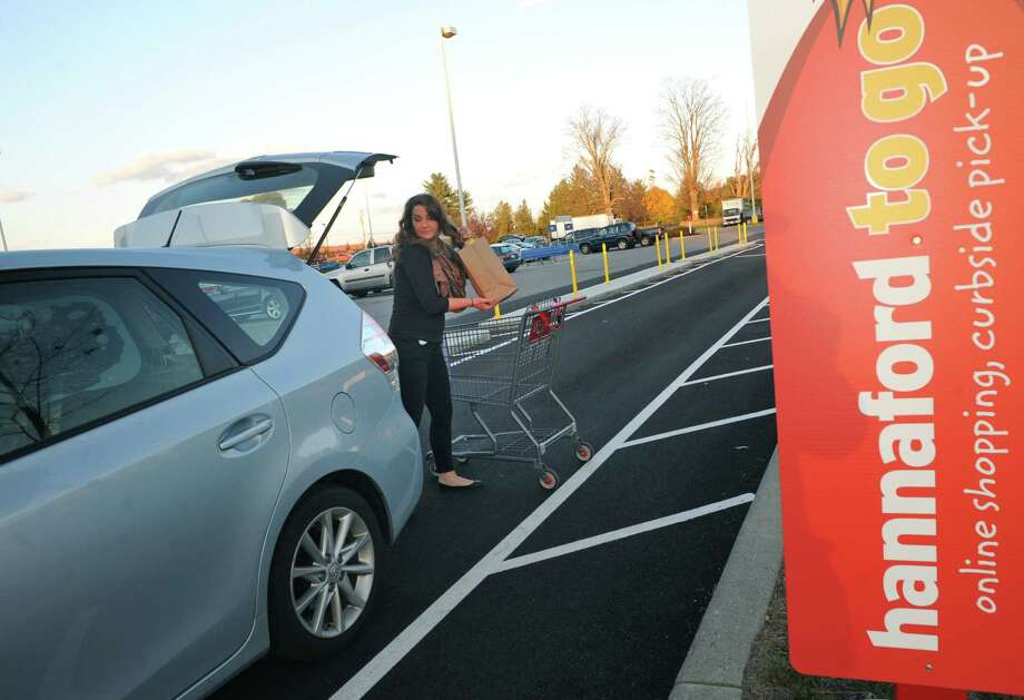 Assistant manager of customer relations Bridget Varney loads a customers vehicle with their order in Hannaford to Go service at the Hannaford on Wednesday Nov. 5, 2014 in Saratoga Springs, N.Y. (Michael P. Farrell/Times Union) Photo: Michael P. Farrell / 00029281A
