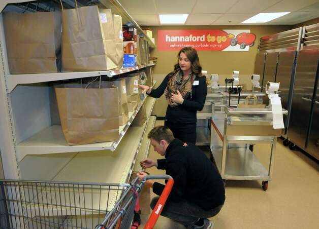 Assistant manager of customer relations Bridget Varney and order expeditor Jonah Eustis check grocery orders for dive up pick up in the Hannaford to Go service at the Hannaford on Wednesday Nov. 5, 2014 in Saratoga Springs, N.Y. (Michael P. Farrell/Times Union) Photo: Michael P. Farrell / 00029281A