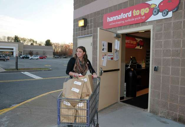 Assistant manager of customer relations Bridget Varney brings an order to a customers vehicle as part of the Hannaford to Go service at the Hannaford on Wednesday Nov. 5, 2014 in Saratoga Springs, N.Y. (Michael P. Farrell/Times Union) Photo: Michael P. Farrell / 00029281A