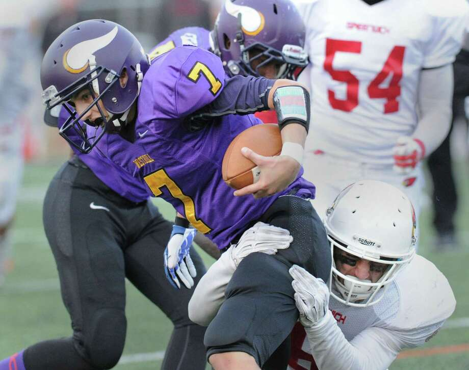 At right, Jack Weigold of Greenwich sacks Westhill quarterback Blake Newcomer (#7) in the final minutes of the 4th quarter during the high school football game between Westhill High School and Greenwich High School at Westhill in Stamford, Conn., Saturday, Nov. 8, 2014. Photo: Bob Luckey / Greenwich Time