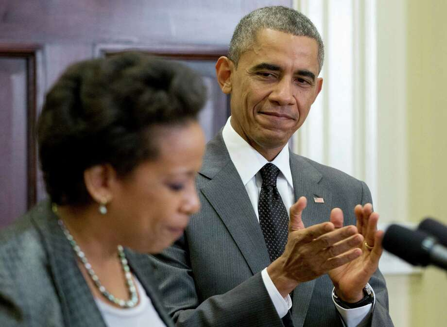 President Barack Obama applauds as US Attorney Loretta Lynch speaks in the Roosevelt Room of the White House in Washington, Saturday, Nov. 8, 2014, where the president announced that he will nominate Lynch to replace Eric Holder as attorney general. (AP Photo/Carolyn Kaster) ORG XMIT: DCCK101 Photo: Carolyn Kaster / AP