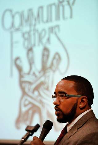 Program director William Rivas introduces the day's speakers at the 2nd Annual Fatherhood Conference held Friday Oct. 24, 2014 at the Schenectady County Community College in Schenectady, N.Y.     (Skip Dickstein/Times Union) Photo: SKIP DICKSTEIN / 00029190