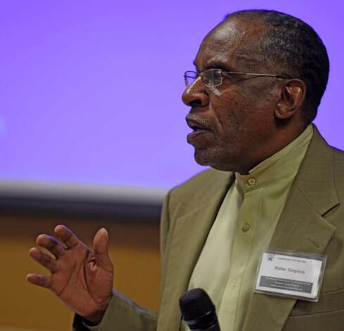 Walter Simpkins opens the 2nd Annual Fatherhood Conference held Friday Oct. 24, 2014 at the Schenectady County Community College in Schenectady, N.Y.     (Skip Dickstein/Times Union) Photo: SKIP DICKSTEIN / 00029190