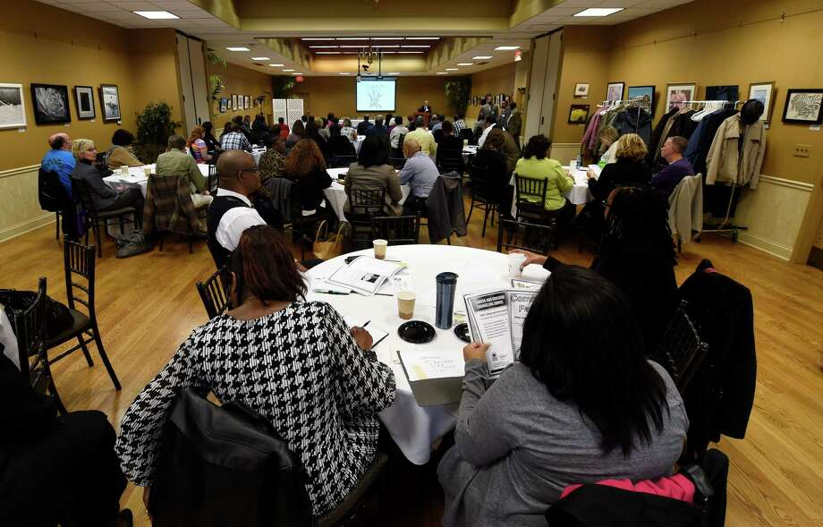 A large turnout listens to speakers at the 2nd Annual Fatherhood Conference held Friday Oct. 24, 2014 at the Schenectady County Community College in Schenectady, N.Y.     (Skip Dickstein/Times Union) Photo: SKIP DICKSTEIN / 00029190