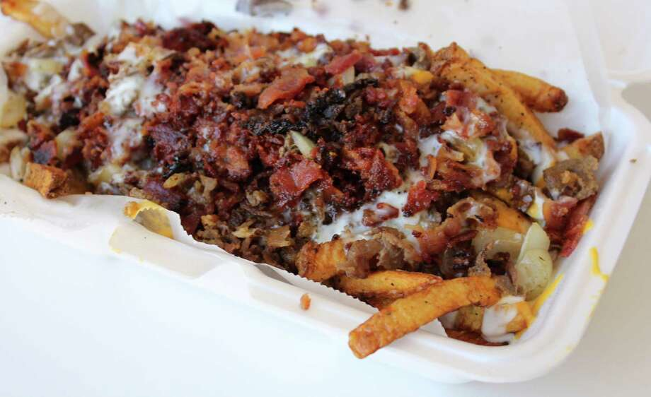 Cheesy Bacon Ranch Fries served with ranch dressing are a guilty pleasure at Malik's Philly's Phamous Cheesesteaks food truck. Photo: Jennifer McInnis / Jennifer McInnis / San Antonio Express-News