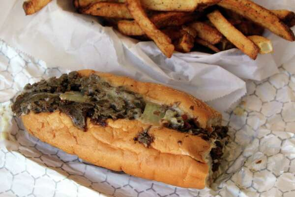 For mySA Just a Taste: An Original Philly comes with steak, grilled onions and creamy white American cheese at Malik's Philly's Phamous Cheesesteaks food truck. (Jennifer McInnis / San Antonio Express-News)
