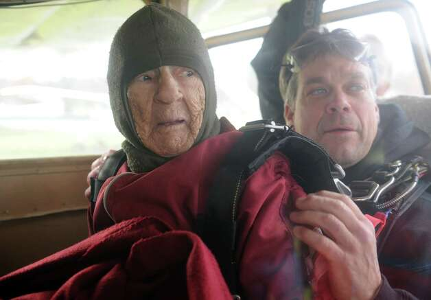 """One-hundred-years-young Eleanor """"Nanny"""" Cunningham, left, with co-parachuter Dean McDonald get situated in the plane prior to their skydive on Saturday Nov. 8, 2014 in Gansevoort, N.Y. (Michael P. Farrell/Times Union) Photo: Michael P. Farrell / 00029372A"""