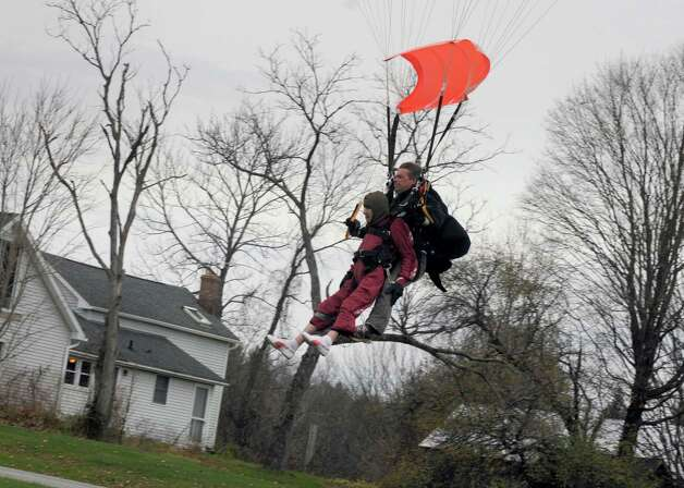 """One-hundred-years-young Eleanor """"Nanny"""" Cunningham and co-parachuter Dean McDonald make their skydive landing on Saturday Nov. 8, 2014 in Gansevoort, N.Y. (Michael P. Farrell/Times Union) Photo: Michael P. Farrell / 00029372A"""
