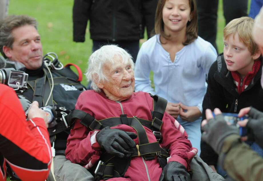 "One-hundred-years-young Eleanor ""Nanny"" Cunningham, left, with co-parachuter Dean McDonald are welcomed by Cunningham's freinds and family after her skydive on Saturday Nov. 8, 2014 in Gansevoort, N.Y. (Michael P. Farrell/Times Union) Photo: Michael P. Farrell / 00029372A"