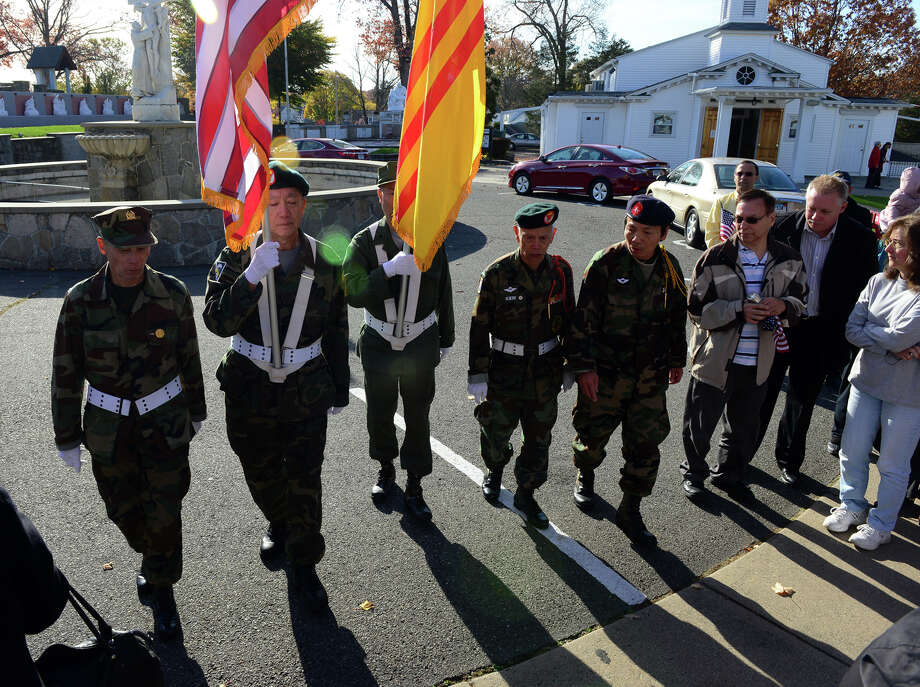 Members from the Vietnamese American Organization in Bridgeport make up the Color Guard during St. Margaret Shrine's Fourth Annual Veterans Day Mass and Ceremony in Bridgeport, Conn., on Saturday November 8, 2014. These men are veterans who fought in Vietnam with the South Vietnamese Army. Thirty one names have recently been added, to the Veterans Memorial, at the Shrine. There are now the names of 198 veterans. Photo: Christian Abraham / Connecticut Post