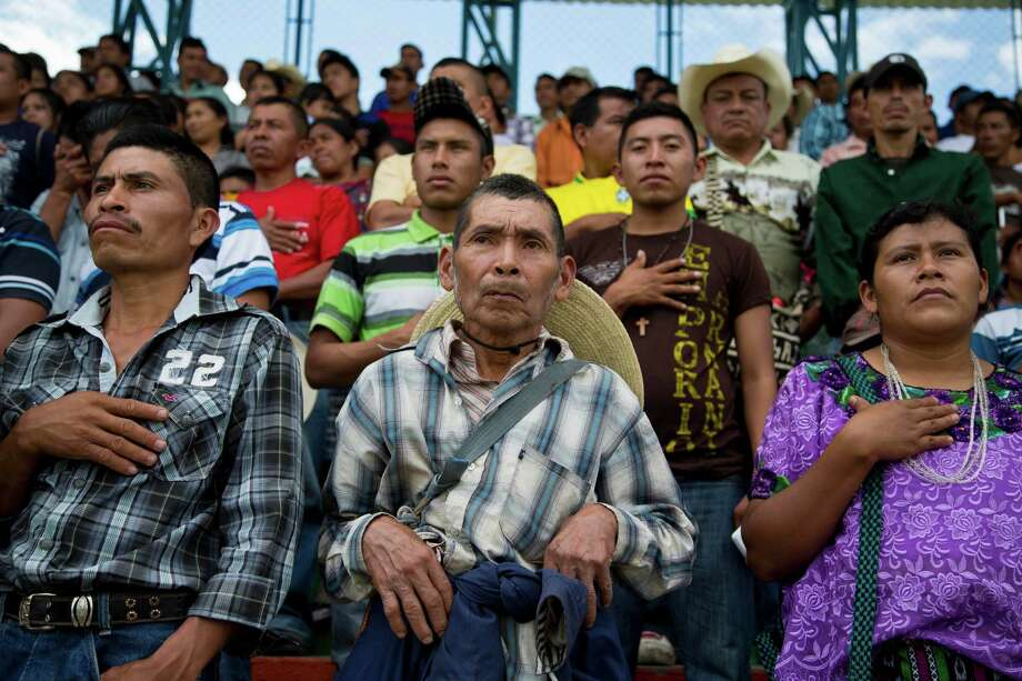 People who were made to abandon their homes due to the construction of a hydroelectric dam, attend a meeting with Guatemalan President Otto Perez Molina in Rabinal, Guatemala, Saturday, Nov. 8, 2014. Perez Molina apologized to members of the surrounding Baja Verapaz communities for human rights violations committed against the Achi Indians, during the construction of the Chixoy Hydroelectric Dam, that began in 1975. (AP Photo/Moises Castillo) Photo: Moises Castillo, STF / AP