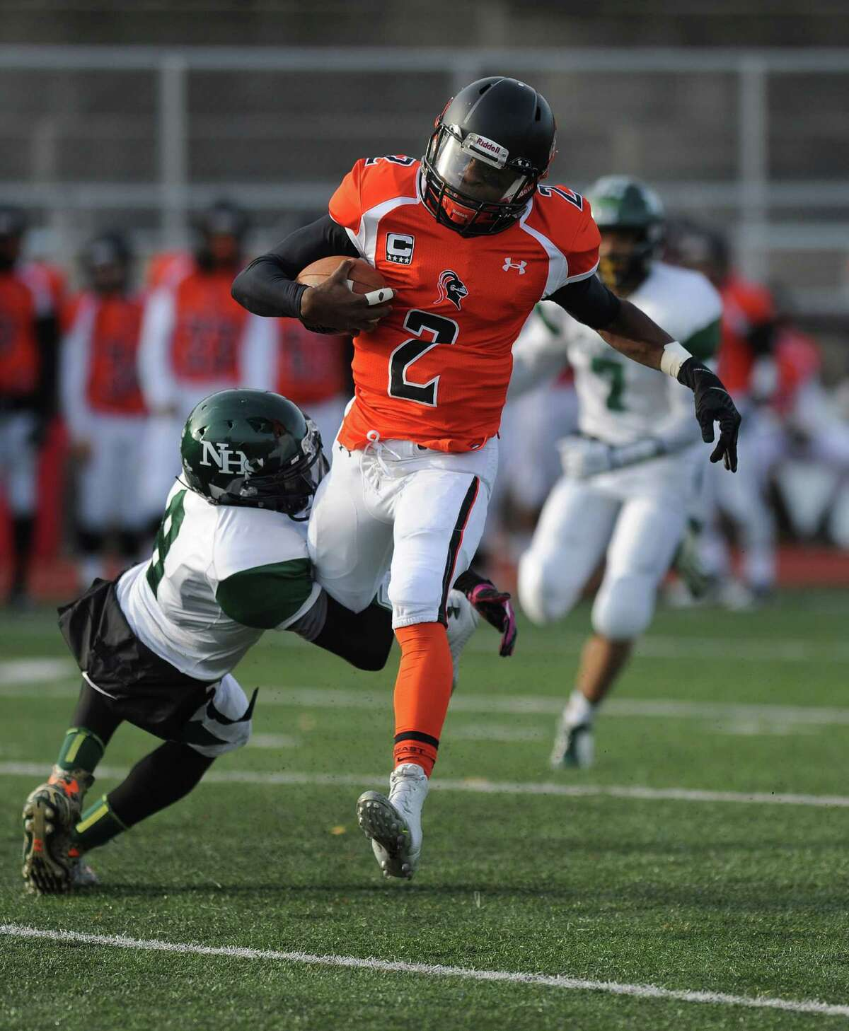 Stamford's Jalen Brown carries the ball during Saturday's football game against Norwalk on November 8, 2014, at Stamford High School.