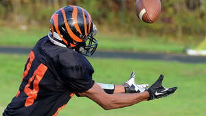 Bullard-Havens' Justin Banks reaches out to catch a pass, during football action against Abbott RVT/Immanulate in Bridgeport, Conn., on Saturday November 8, 2014. Banks fumbled the pass.
