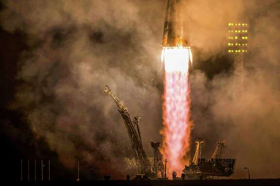 A Soyuz rocket launches the Expedition 41 crew of Alexander Samokutyaev, Elena Serova and Butch Wilmore on Sept. 26.