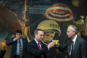 NASA executives Sean Fuller, center, and William Gerstenmaier toast the successful launch.
