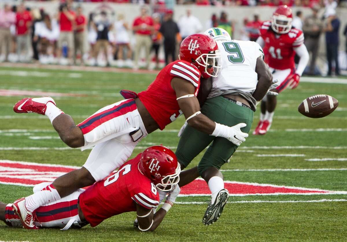 Nov. 8: Tulane 31, Houston 24 Record: 5-4 Houston Cougars defensive backs Turon Walker, above, and Howard Wilson, below, cause a fumble after colliding with Tulane Green Wave wide receiver Teddy Veal during the first half of an AAC football game at TDECU Stadium, Saturday, Nov. 8, 2014, in Houston. The fumble resulted in a touchdown. (Cody Duty / Houston Chronicle)