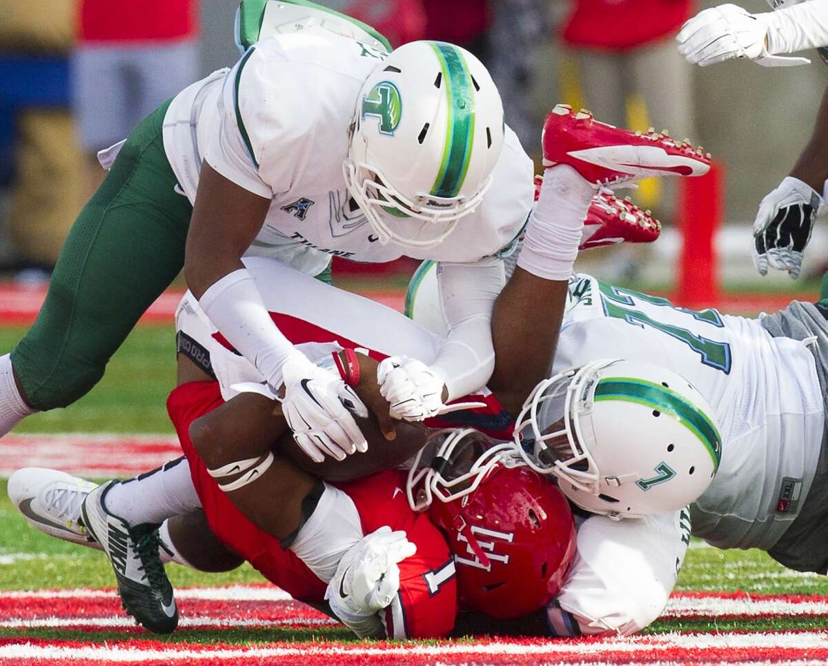 Tulane Green Wave linebacker Nico Marley, left, and Edward Williams, right, sack Houston Cougars quarterback Greg Ward, during the first half of an AAC football game at TDECU Stadium, Saturday, Nov. 8, 2014, in Houston. (Cody Duty / Houston Chronicle)