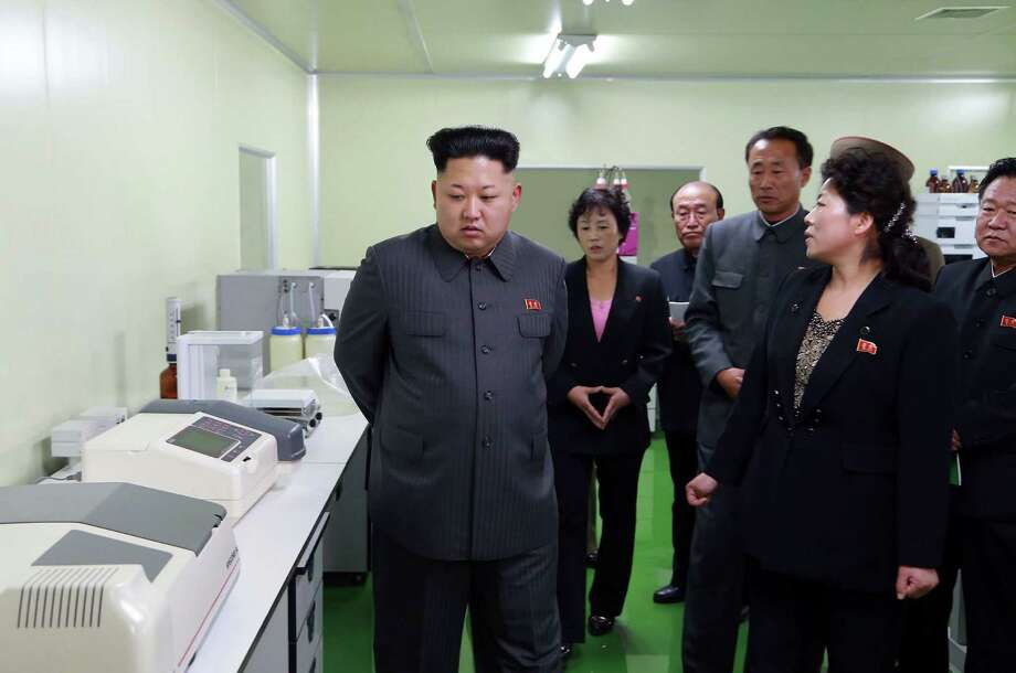 "This undated picture released from North Korea's official Korean Central News Agency (KCNA) on November 8, 2014 shows North Korean leader Kim Jong-Un (L) inspecting the Jongsong pharmaceutical general factory at undisclosed place in North Korea.  AFP PHOTO / KCNA via KNS    REPUBLIC OF KOREA OUT THIS PICTURE WAS MADE AVAILABLE BY A THIRD PARTY. AFP CAN NOT INDEPENDENTLY VERIFY THE AUTHENTICITY, LOCATION, DATE AND CONTENT OF THIS IMAGE. THIS PHOTO IS DISTRIBUTED EXACTLY AS RECEIVED BY AFP. ---EDITORS NOTE--- RESTRICTED TO EDITORIAL USE - MANDATORY CREDIT ""AFP PHOTO / KCNA VIA KNS"" - NO MARKETING NO ADVERTISING CAMPAIGNS - DISTRIBUTED AS A SERVICE TO CLIENTSKNS/AFP/Getty Images Photo: KNS / AFP"