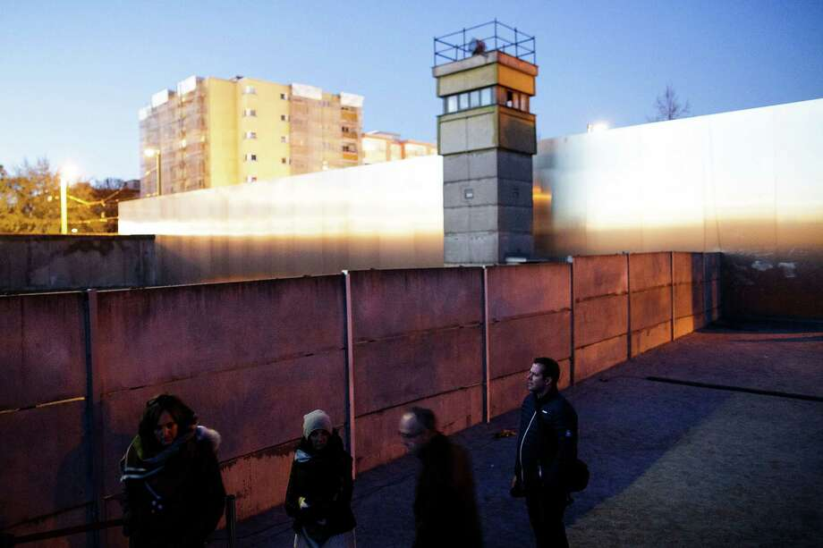 """A former """"death strip,"""" complete with what was once a watch tower, is now a park known for its Sunday flea market and open-air karaoke. Activist Frank Ebert says people don't understand """"how horrible it really was"""" in East Berlin. Photo: Carsten Koall, Stringer / 2014 Getty Images"""