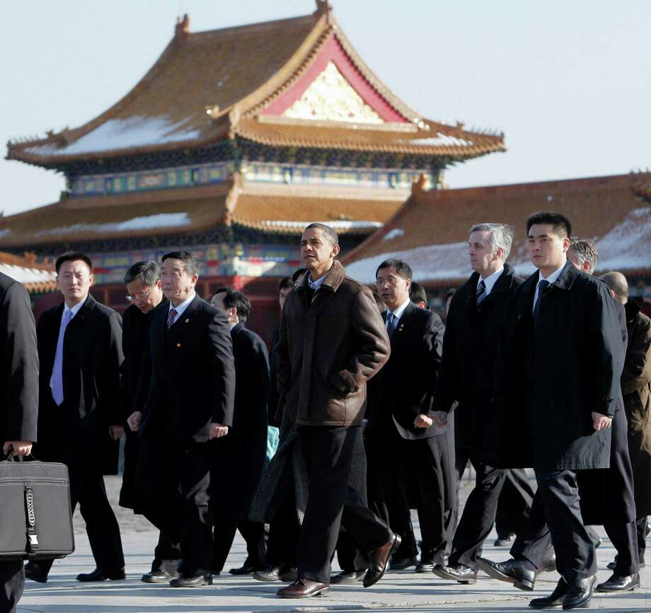 FILE - In this Nov. 17, 2009 file photo, President Barack Obama tours the Forbidden City in Beijing. His influence at home quickly fading, President Barack Obama is looking east to China, the opening stop of a three-country tour that will test his ability to play a commanding role on the world stage during his final two years in office. Once treated like a global superstar, Obama arrives in Beijing on Monday with his most powerful days behind him. Even as Obama prepared to leave Washington early Sunday, Republicans were still rejoicing at having pummeled the president's party in the midterm elections, relegating Democrats to the minority in both chambers of Congress. (AP Photo/Charles Dharapak, File) Photo: Charles Dharapak, STF / AP