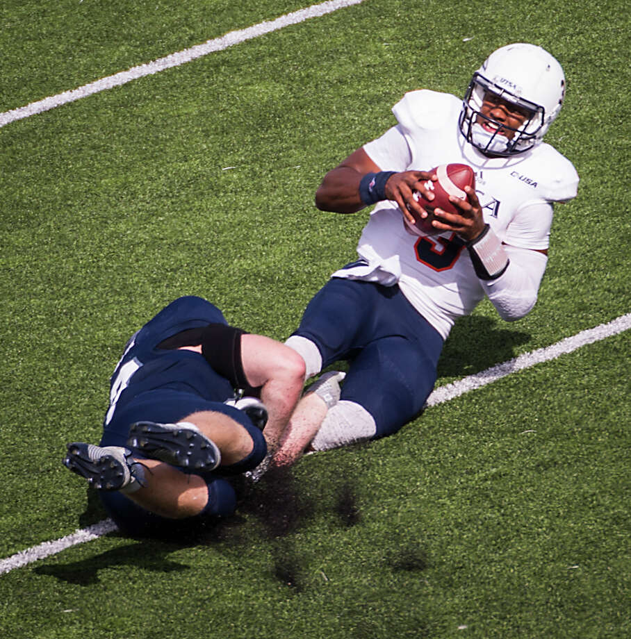 Rice's Brian Nordstrom twists UTSA's Austin Robinson to the turf for a fourth-quarter sack. Photo: Smiley N. Pool, Staff / © 2014  Houston Chronicle
